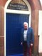 RESIZED Dr Jim Murray at the Door of the Hauley Lodge.jpg